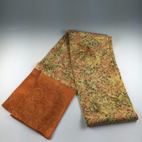 A windfall of leaves in autumn colors adorns the vintage silk body